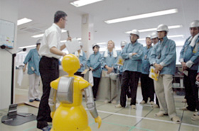 Observing robots at Kobe Shipyard & Machinery Works, Mitsubishi Heavy Industries, Ltd.