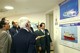 The ambassadors listen to an explanation of the exhibits at EE Park,