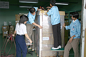 Cargo being packaged for land transportation